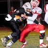 F. BRIAN FERGUSON/THE REGISTER-HERALD=Woodrow Wilson's Ramon Edwards III picks up some yards as Parkersburg's Aaron Roberts tries to make the tackle during Friday evening action in Beckley.