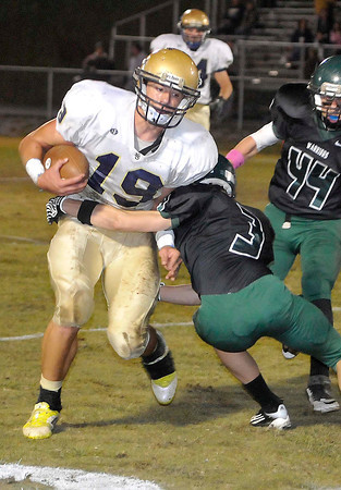 Shady Spring Houstin Syvertson, breaks the tackle of Wyoming East Casey Saunders for a few extra yards during their game at Wyoming East High School Friday night. Photo by Chris Tilley