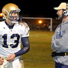 Shady Springs High School quarterback Adam Weeks talks over a play with Head Coach Vince Culicerto during their game with Wyoming East High School Friday night. Photo by Chris Tilley