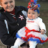 Tesa Danieley, Independence cheerleader, holds Maggie Viars, Little Miss Patriot Queen, she's the daughter of Stephen and Sandy Viars of Sophia. She was announce queen before the start of the Independence vs Liberty game at Independence High School<br /> Rick Barbero/The Register-Herald