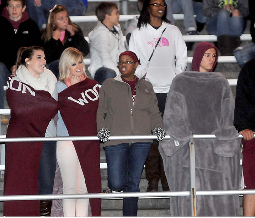 F. BRIAN FERGUSON/THE REGISTER-HERALD=Woodrow Wilson fans tried their best to stay warm as they cheered on their Flying Eagles as they took the field against Parkersburg during Friday evening action in Beckley.
