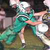 Jacob Alton, 1, of Fayetteville, left, tries to bring down, Malik Boatwright, 11, of Greenbrier West, during game Friday night in Fayetteville.<br /> Rick Barbero/The Register-Herald