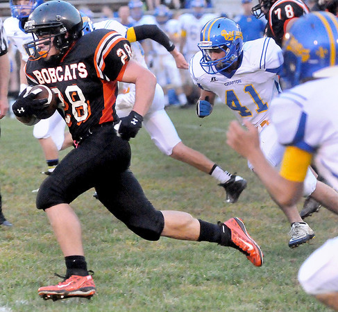 F. BRIAN FERGUSON/THE REGISTER-HERALD=Summers County's Dustin Smith, left, runs for a big gain as Grafton's Abrahm Blair, right, tries to track him down on Friday evening in Brooks.