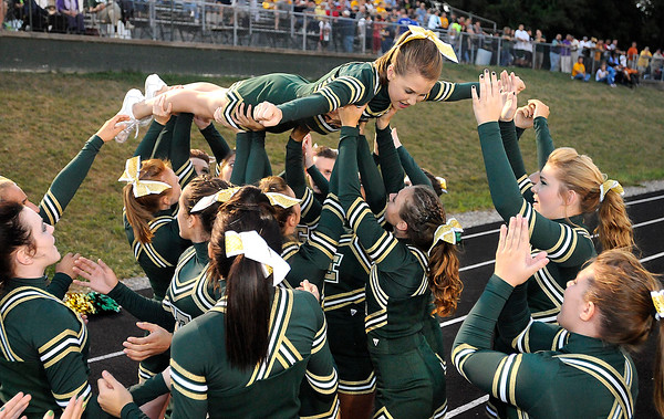 Greenbrier East cheerleaders cheer during game against Shady Spring Friday night in Fairlea.<br /> Rick Barbero/The Register-Herald