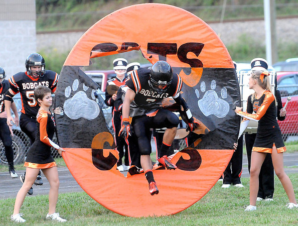 F. BRIAN FERGUSON/THE REGISTER-HERALD=Summers County's T. J. Smith tears through the banner  on Friday evening in Brooks.