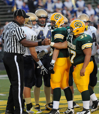 Tre' Moore, 37, of Greenbrier East, shakes the officials hand before the game against Shady Spring Friday night in Fairlea.<br /> Rick Barbero/The Register-Herald