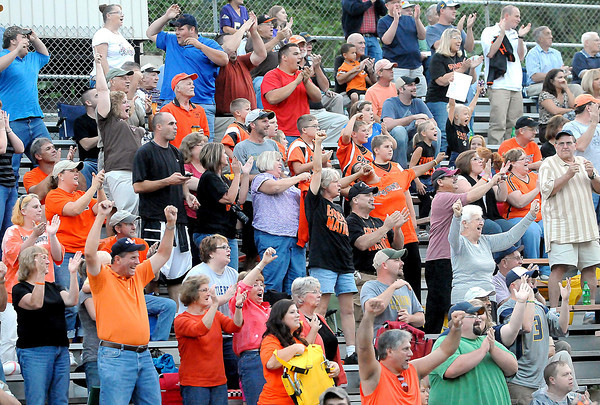 F. BRIAN FERGUSON/THE REGISTER-HERALD=Summers County fans cheer as Matt Ryan runs back the opening kick-off for a touchdown against Grafton on Friday evening in Brooks.