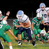 F. BRIAN FERGUSON/THE REGISTER-HERALD=Fayetteville's Aaron Krise, and  Zack Hopkins, center, attempt to tackle Meadow Bridge's Jacob Parker  during Friday's action in Fayetteville.