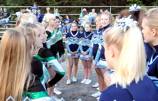 F. BRIAN FERGUSON/THE REGISTER-HERALD=Fayetteville's and Meadow Bridge's cheerleaders introduced themselves before Friday's game in Fayetteville.