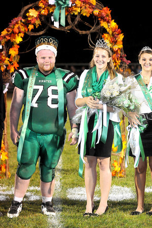 F. BRIAN FERGUSON/THE REGISTER-HERALD=Fayetteville's Homecoming King, Mike Linkenhoker, left, and Queen, Jessica Brown, both seniors, proudly wear their crowns at halftime during the pirates game with Meadow Bridge.