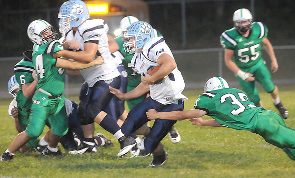 F. BRIAN FERGUSON/THE REGISTER-HERALD=Fayetteville takes on  Meadow Bridge during Friday's action in Fayetteville.