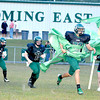 Wyoming East Warriors running onto the field Friday Night for their home game with Summers County High School.