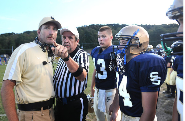 Shady Spring head coach, Vince Culicerto, left, speaks to a referee during his game against Independence Friday night at Shady Spring High School.<br /> Rick Barbero/The Register-Herald
