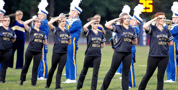 The Shady Springs High School Dance Team salute the flag  during the National Anthem before Friday Nights football game with Pikeview at Shady Spring High School.