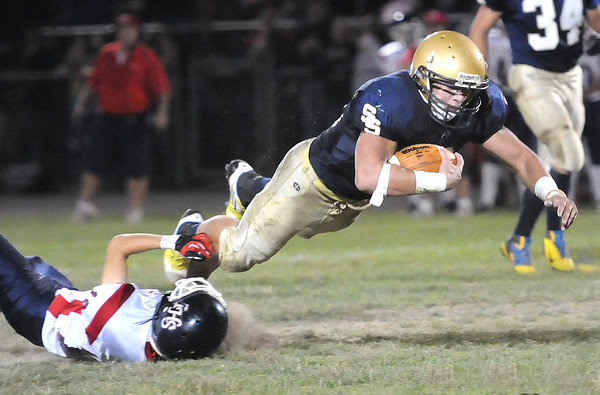 Houstin Syvertson, 19, of Shady Spring, dives for extra yards against Independence Friday night at Shady Spring High School.<br /> Rick Barbero/The Register-Herald