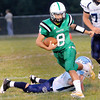 F. BRIAN FERGUSON/THE REGISTER-HERALD=Fayetteville's Quarterback Aaron Krise runs for some yards against Meadow Bridge during Friday's action in Fayetteville.