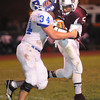 Ramon Edwards III, of Woodrow Wilson, right, tries to get away from Nathan Tucker, of Ripley Friday night at Van Meter Stadium in Beckley<br /> Rick Barbero/The Register-Herald