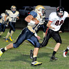 Shady Springs Houstin Syvertson runs the ball Friday night with Pikeviews Logan McKinney looking to make the tackle.