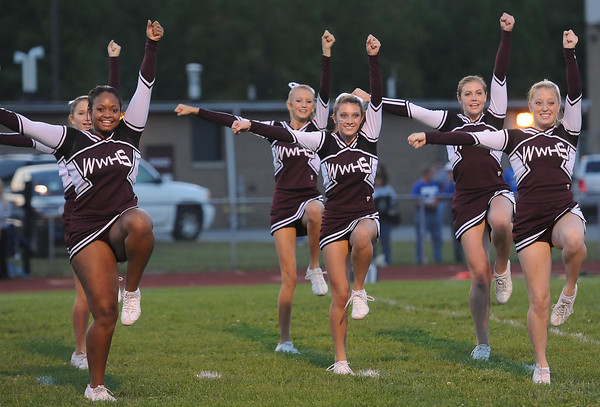 Woodrow Wilson cheerleaders during game against Ripley Friday night at Van Meter Stadium in Beckley<br /> Rick Barbero/The Register-Herald