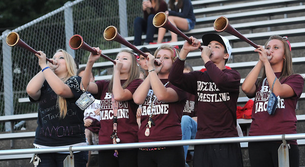 Woodrow Wilson fans blow horns during game against Ripley Friday night at Van Meter Stadium in Beckley<br /> Rick Barbero/The Register-Herald