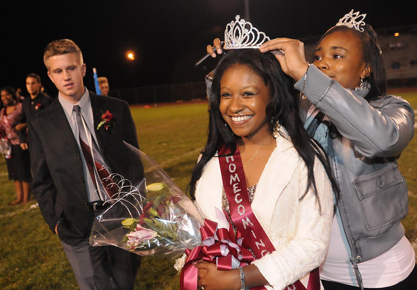 Drew Woolridge, Homecoming King, left, watches Shaitece Trigg, last years Homecoming Queen, crown, Brianna Booker, during halftime of the Woodrow Wilson vs Ripley Friday night at Van Meter Stadium in Beckley<br /> Rick Barbero/The Register-Herald