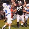 Jacob Van Meter, of Woodrow Wilson, right, charges in on Jake Martin, of Ripley, Friday night at Van Meter Stadium in Beckley<br /> Rick Barbero/The Register-Herald