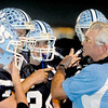 Meadow Bridge Head Coach Larry McClintic take a time out during their cam with Valley on Friday Night at Meadow Bridge High School.