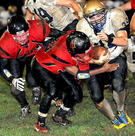 F. BRIAN FERGUSON/THE REGISTER-HERALD=Oak Hill's Antonio Gray, center, puts a hit on Shady Spring's, Jordan Palchesko, right. during the Red Devils Homecoming game in Oak Hill.