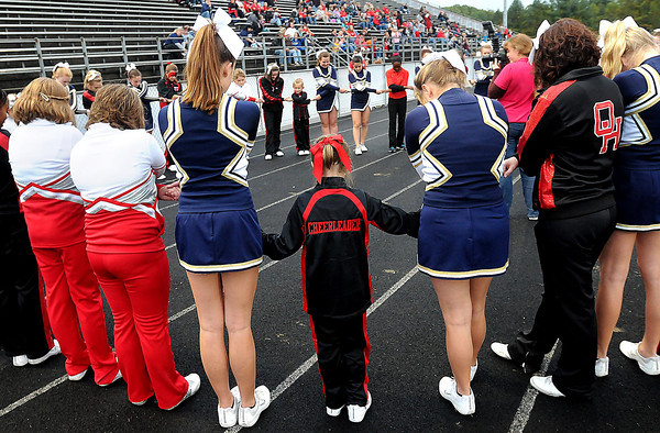 F. BRIAN FERGUSON/THE REGISTER-HERALD=Oak Hill and  Shady Spring cheerleaders joined hands before the start of the the Red Devils<br /> 's Homecoming game in Oak Hill.