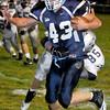 Meadow Bridge Jake Parker runs the ball with Valleys Casey Stewartduring Friday Nights match up at Meadow Bridge High School.