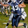 Meadow Bridge Jake Parker runs the ball with Valleys Casey Stewart during Friday Nights match up at Meadow Bridge High School.