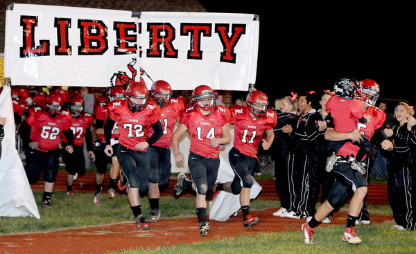 the Liberty High School football team coming onto the field Friday night as they host James Monroe.