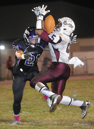Riverside defends Ramon Edwards III, 5, of Woodrow Wilson Friday night at Riverside High School in Belle.<br /> Rick Barbero/The Register-Herald