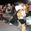 Emma Cook, playing the snare drum for the Summers Co. marching band, dressed up as Batman Bobcat during game against Valley Friday night at Summers Co. High School<br /> Rick Barbero/The Register-Herald