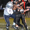 Isaiah Brown, 1, of Summers Co. tries to break away for some extra yards against, Keyshawn Payne, 8, of Valley Friday night at Summers Co. High School.<br /> Rick Barbero/The Register-Herald