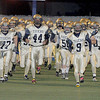 The Shady Spring High School football team storm onto the field for  Friday nights game with Musselman at Princeton High School. Photo by Chris Tilley
