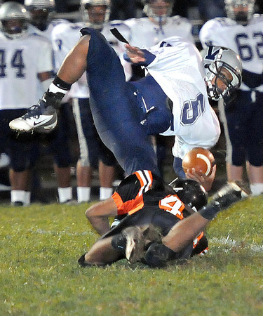 Markiece Lukach. 44, of Summers Co. Brings down Myles White, 5, of  Valley Friday night at Summers Co. High School<br /> Rick Barbero/The Register-Herald