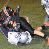 Matt Ryan, 2, of Summers Co. dives over Casey Stewart, 25, of Valley Friday night at Summers Co. High School<br /> Rick Barbero/The Register-Herald
