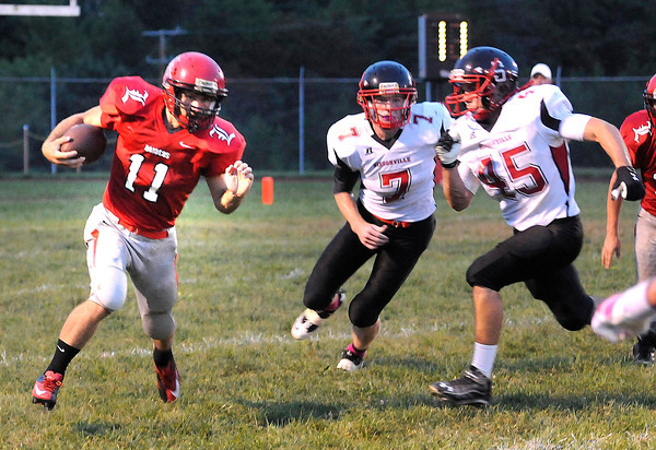 Ryan Moore, 11, of Liberty Raiders, left,  runs away from Jeffery Stowers, 7, and Cameron McLane, 45, of Sissonville.<br /> Rick Barbero/The Register-Herald