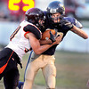 F. BRIAN FERGUSON/THE REGISTER-HERALD=Richwood's Cory Chambers, left, puts a hit on Greenbrier West receiver Josh Martin after a pass reception in Charmco.