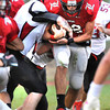 Matthew Bailey, 22, of Liberty Raiders tries to break away from a Sissonville defender Friday at Liberty High School<br /> Rick Barbero/The Register-Herald