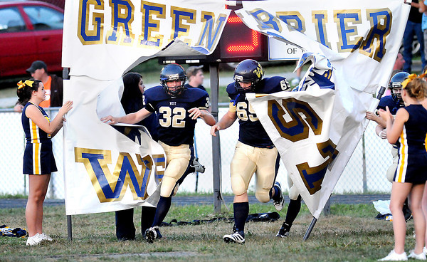 F. BRIAN FERGUSON/THE REGISTER-HERALD=Greenbrier West burst onto the field to take onRichwood at Charmco.