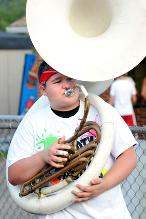 Bobby Davis playing the tuba during the Liberty vs Sissonville game Friday night at Liberty High School<br /> Rick Barbero/The Register-Herald