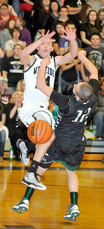 Wyoming East Austin Canada take a charge form Westside's Cory Bowles during Friday nights game at Westside High School. Photo by Chris Tilley