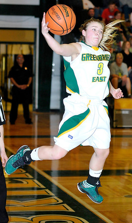 Greenbrier East guard Chloe Honaker jump out to save a lose ball Saturday Night in their game with Washington at Greenbrier East High School. Photo by Chris Tilley