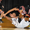 Woodrow Wilson Chase Hancock, fights for the loss ball  with Nitos Angelo Sirianni during Tuesdays game at the Beckley Convention Center. Photo by Chris Tilley