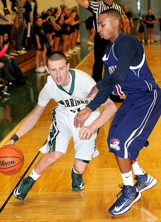 F. BRIAN FERGUSON/THE REGISTER-HERALD=Wyoming East's Austin Canada, left, drives the ball  against Bluefields Lykel Collier, right, during Friday evening action in New Richmond.