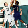 F. BRIAN FERGUSON/THE REGISTER-HERALD=Wyoming East's #40 defends   against Bluefields David Edwards, right, during Friday evening action in New Richmond.