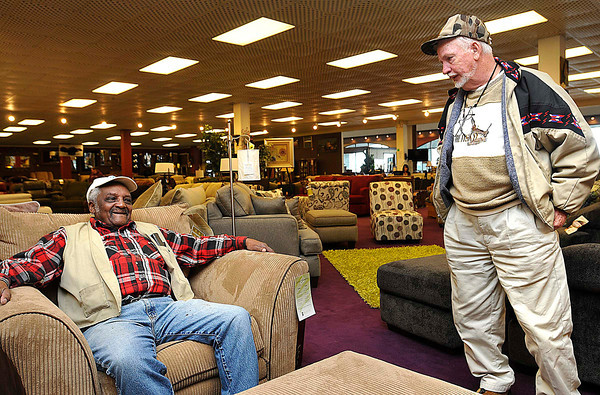 "William ""Inky"" Whitehead, left, talks with John Eye at John Eye Big Sandy store in Beckley.<br /> Rick Barbero/The Register-Herald"