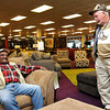 "William ""Inky"" Whitehead, left, talks with John Eye at John Eye Big Sandy store in Beckley.<br /> Rick Barbero/The Register-Herald"